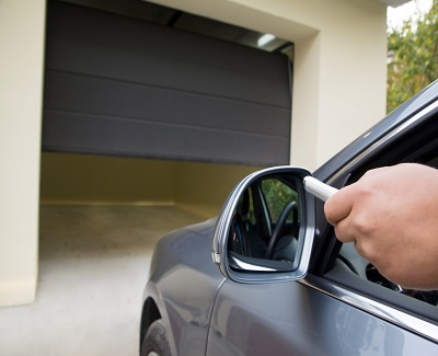 driver opens the garage with remote control from the comfort of a car