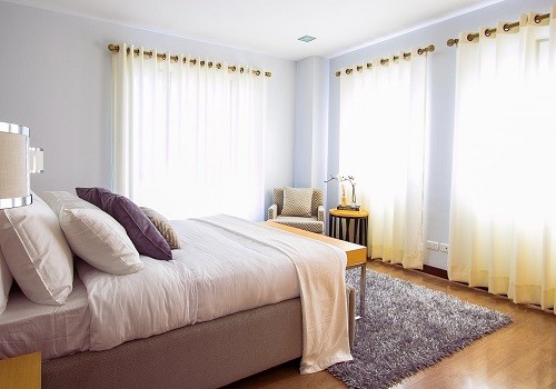 clean bedroom with light curtains