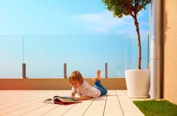 kid reading in rooftop deck