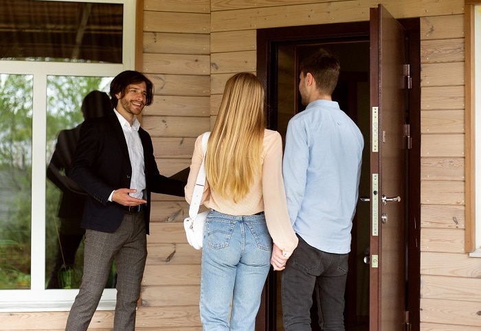 real estate agent guiding prospective buyers