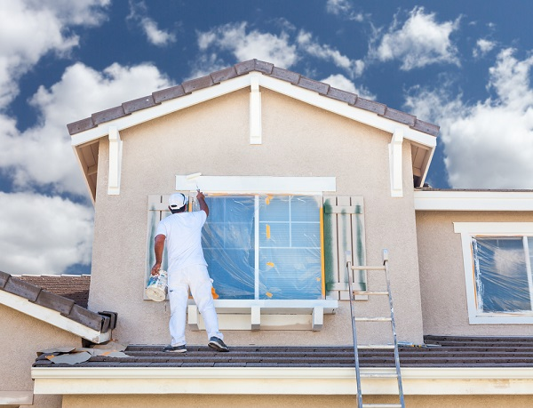 professional house painter painting trim shutters