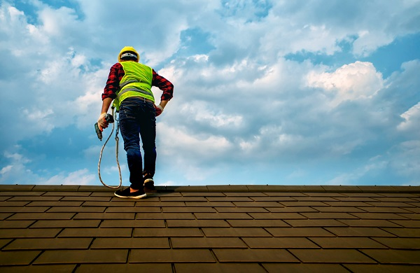 worker doing roof maintenance check