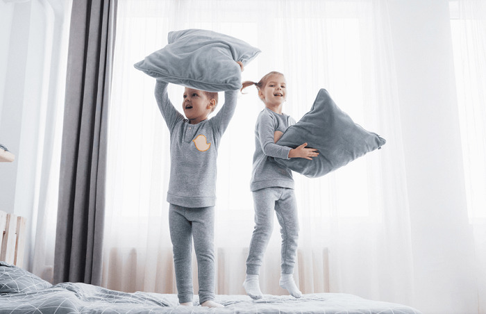 kids playing in bed
