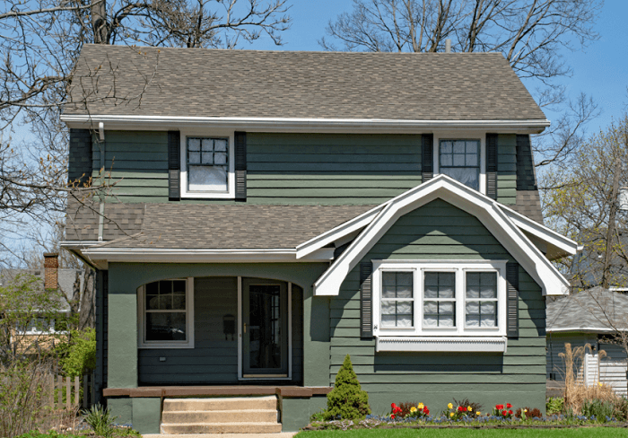 two-storey house with spring flowers