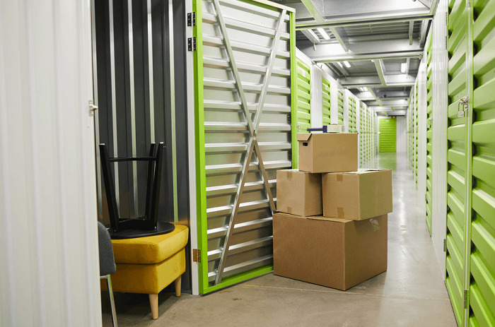 self storage unit with chairs and boxes